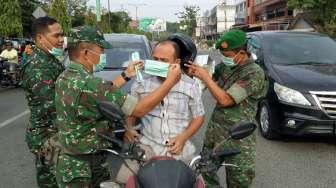 Abu Sinabung Sampai Lhokseumawe, Aparat Bagikan 1.000 Masker