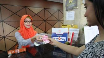 Bank Mandiri - Pos Indonesia Perluas Layanan Top Up e-Money