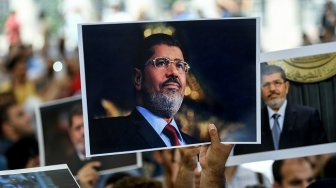 Amnesty International Desak Penyelidikan Independen Kematian Morsi