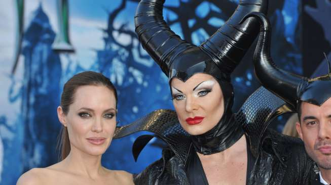 "LOS ANGELES, CA - MAY 29, 2014: Angelina Jolie & characters at the world premiere of her movie ""Maleficent"" at the El Capitan Theatre, Hollywood."