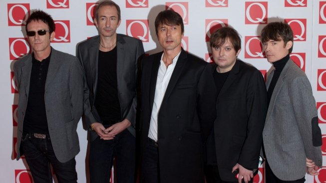 Band Suede [Andrew Cowie / AFP]